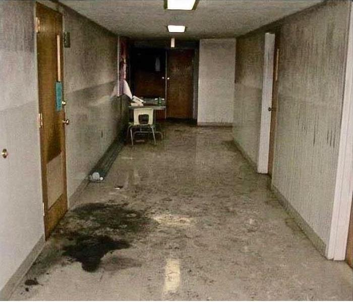 corridor in commercial building with filthy soot and smo9ke stains on all surfaces
