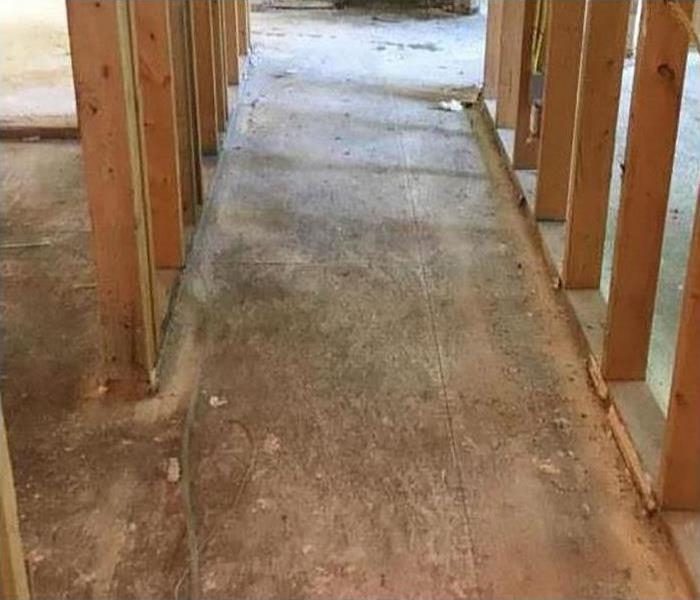 walls exposed and flooring removed during restoration process
