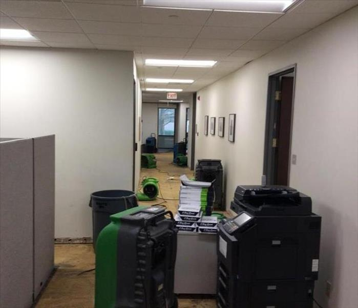 drying equipment in an office pulled carpet, bare floor
