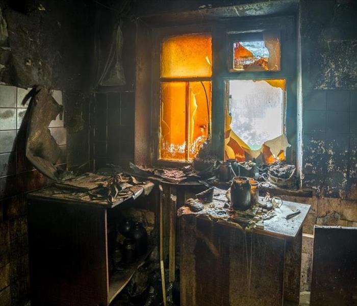 inside of house with soot and burned furniture