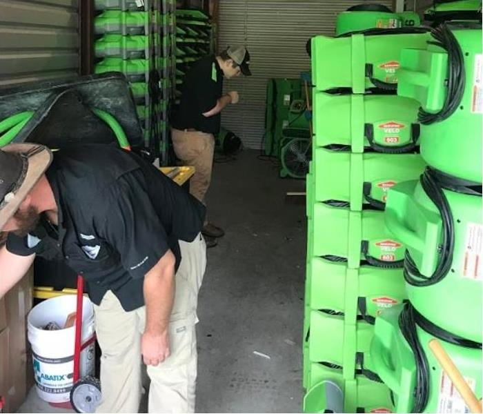 SERVPRO technicians working with restoration equipment in storage facility