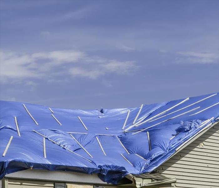 Tarp over a roof
