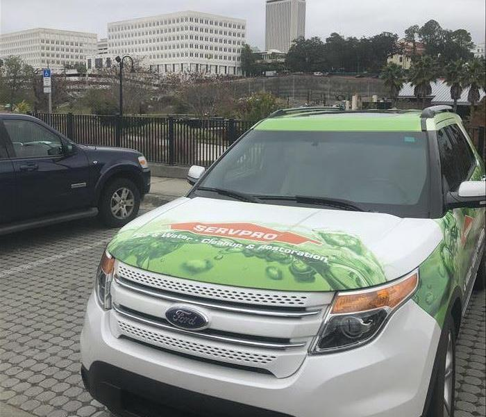 SERVPRO sales vehicle with city background
