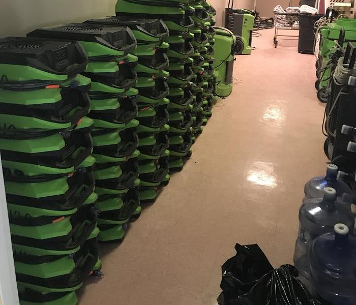SERVPRO equipment stacked in hallway of building upon completion of job